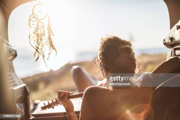 woman at summer road trip - dreamcatcher stock pictures, royalty-free photos & images