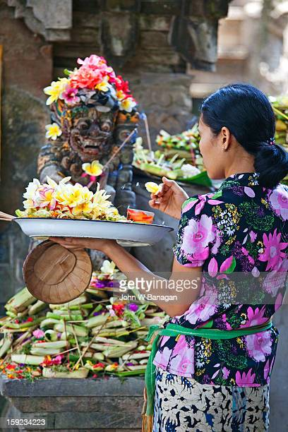 Woman at temple performing ritual, Ubud, Bali