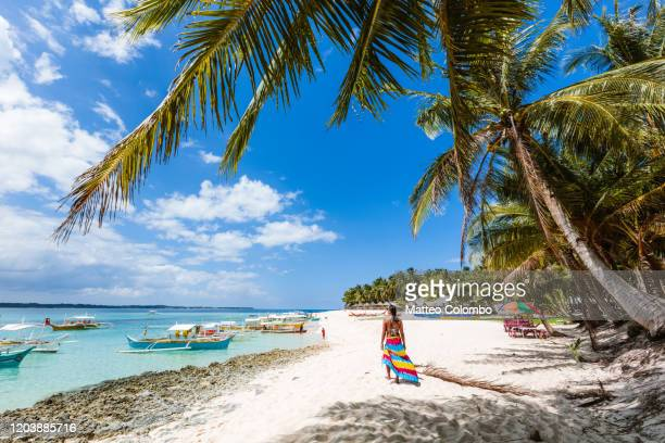 woman at the beach, daku island, siargao, philippines - mindanao stock pictures, royalty-free photos & images