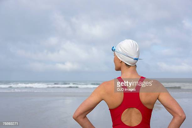 Woman at the beach looking at the ocean