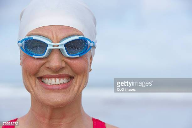 Woman at the beach wearing swimming goggles