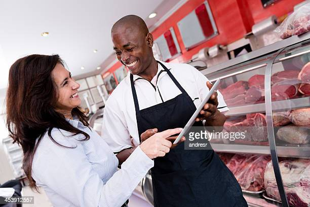 Woman at the butchers