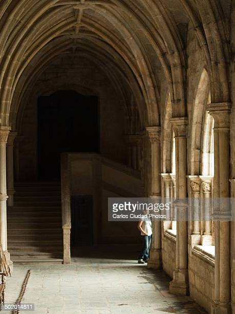 Woman at the cloister of the Cathedral of Evora
