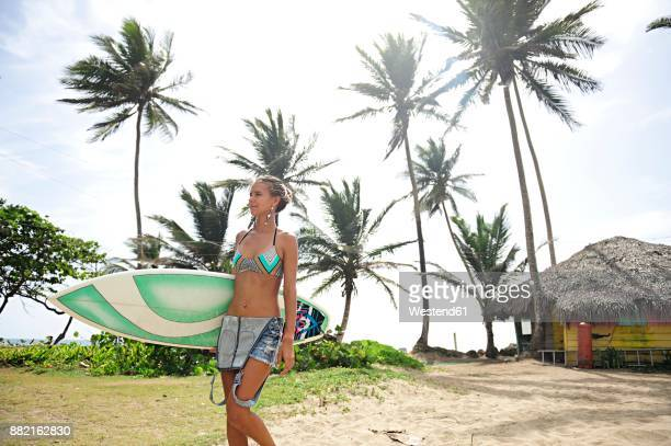 Woman at the coast with surfboard