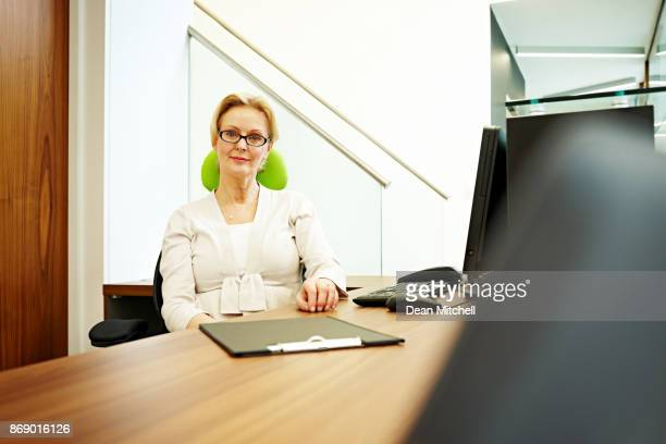 Woman at the dental office in front desk
