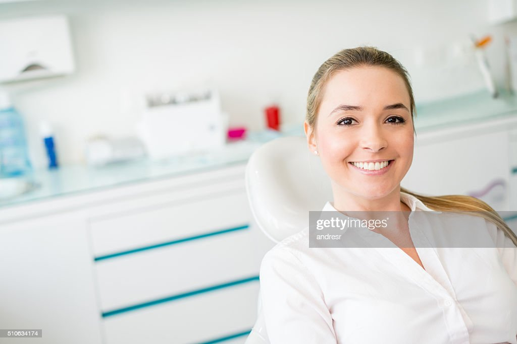 Woman at the dentist : Stock Photo