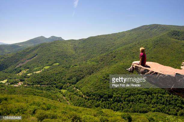 woman at the edge of the cliff of the zamariain viewpoint, navarre, spain. - navarra stock pictures, royalty-free photos & images