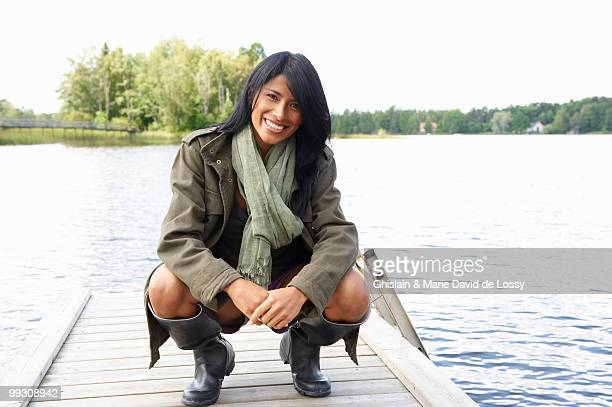 Woman at the end of a dock, smiling