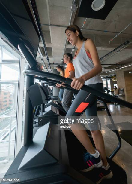 Woman at the gym exercising on a the stair machine