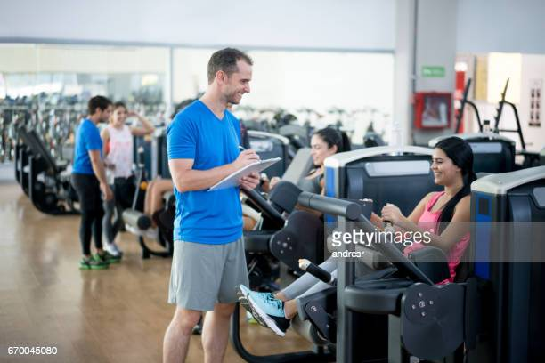 Woman at the gym exercising with her personal trainer
