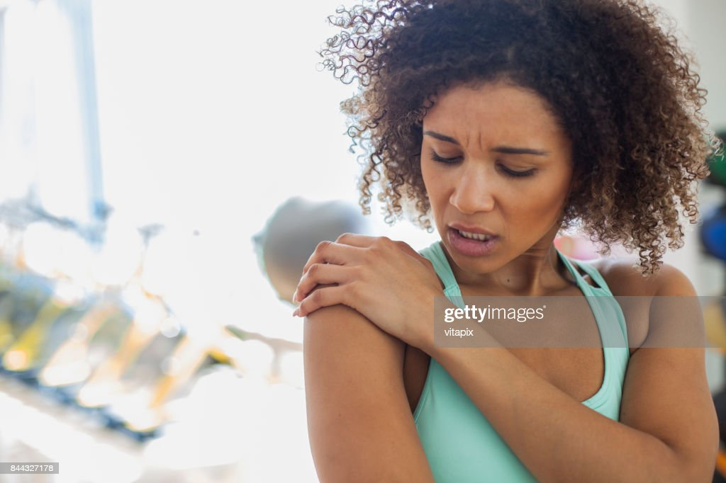 Woman at the Gym Experiencing Pain : Stock Photo