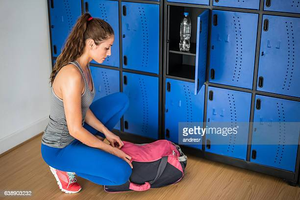 Woman at the gym in the lockers