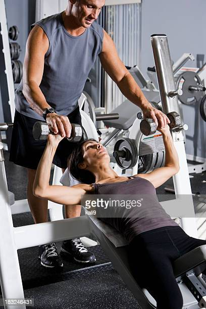 Woman at the gym with personal trainer