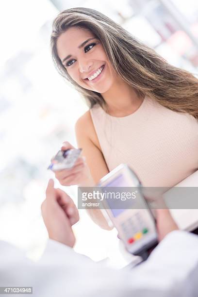 Woman at the hairdresser paying by card