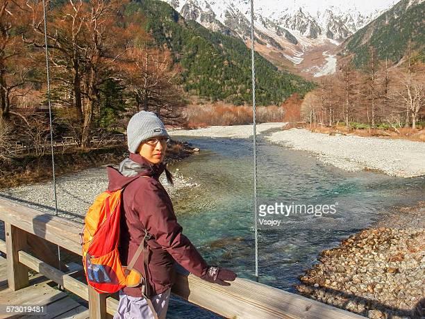 woman at the kappa-bashi bridge, kamikochi - vsojoy stock pictures, royalty-free photos & images