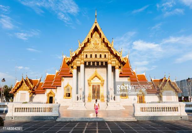 woman at the marble temple (wat benchamabophit) - wat benchamabophit stock photos and pictures