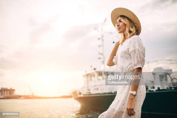 woman at the marina - dress stock pictures, royalty-free photos & images