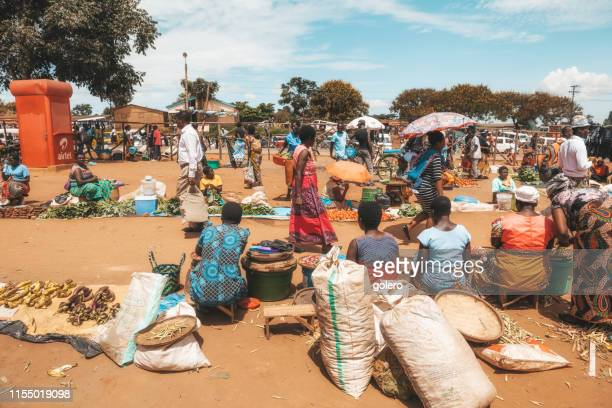 woman at the market in mzuzu - malawi stock pictures, royalty-free photos & images