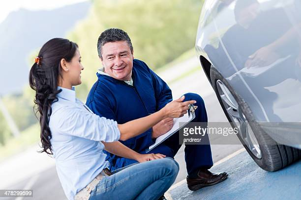 woman at the mechanic - flat tire stock pictures, royalty-free photos & images