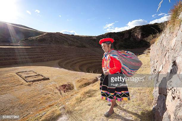 woman at the moray archaeological site, near cusco. peru - hugh sitton stock pictures, royalty-free photos & images