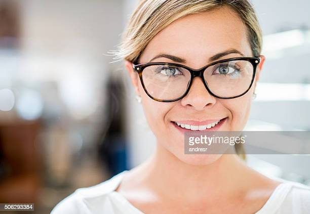 Woman at the optician wearing glasses
