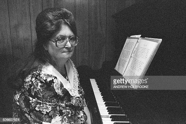 Woman at the piano in church Snake handlers worshiping at the Church of the Lord Jesus in Jolo West Virginia Also known as serpent handlers they sing...
