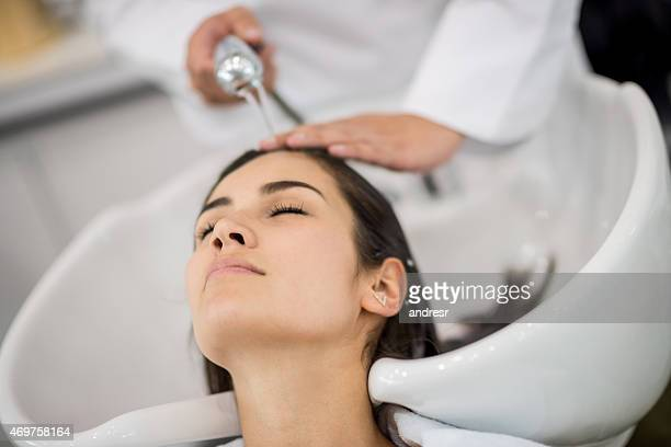 Woman at the salon getting her hair washed
