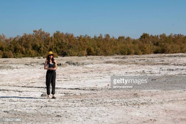 woman at the salton sea - lake bed stock pictures, royalty-free photos & images