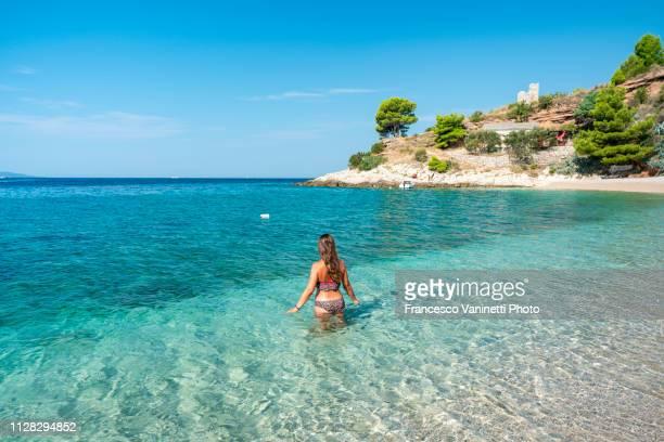 woman at the seaside, brac island, croatia. - croatia stock pictures, royalty-free photos & images
