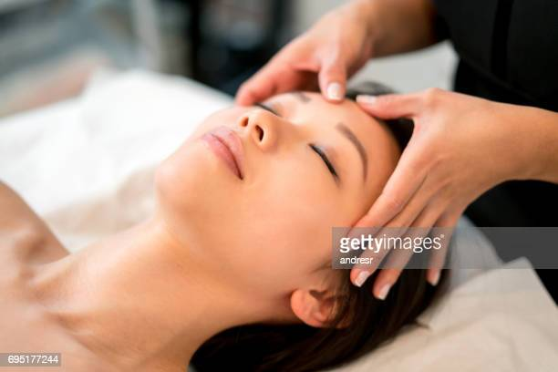 Woman at the spa getting a facial massage