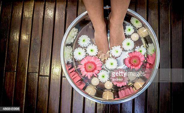 Woman at the spa with feet in water