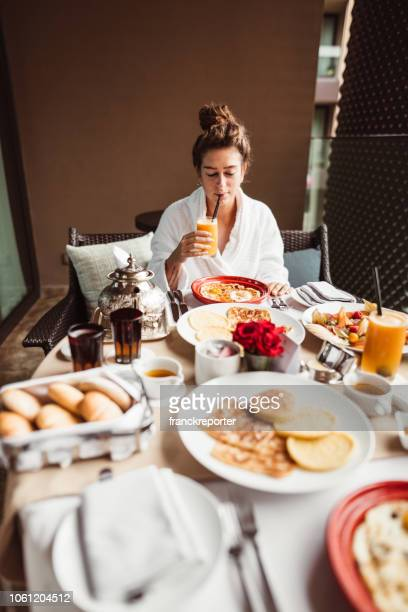 woman at the table for the buffet breakfast with fruit