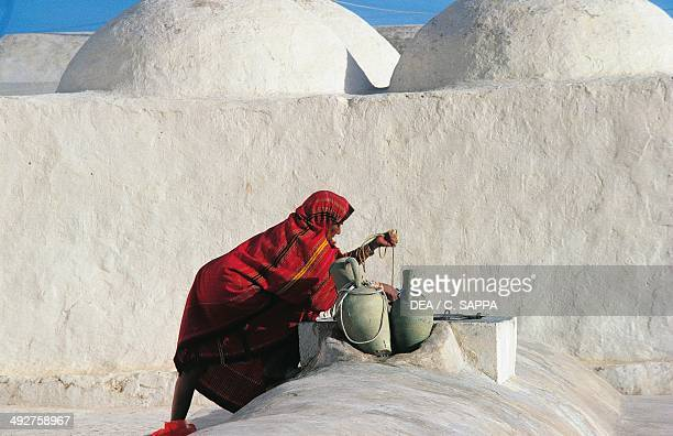 Woman at the well Djerba Tunisia