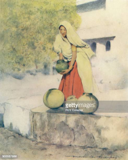 'A Woman at the Well Jeypore' 1905 From India by Mortimer Menpes Text by Flora A Steel [Adam Charles Black London 1905] Artist Mortimer Luddington...