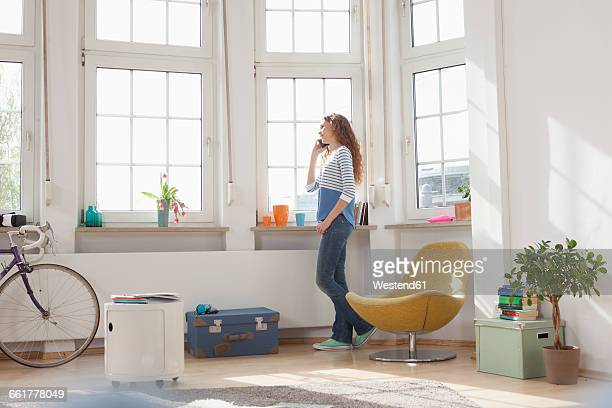 Woman at the window on the phone