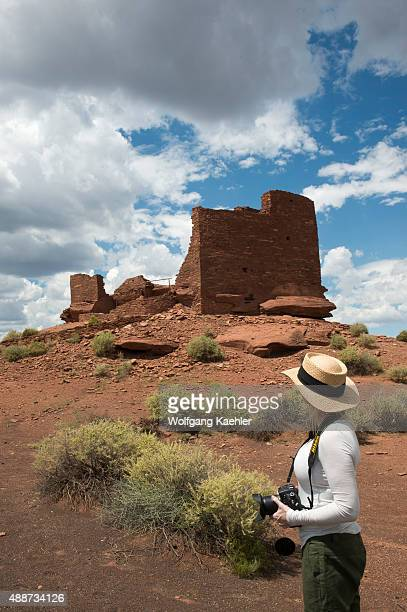 Woman at the Wukoki Pueblo in the Wupatki National Monument Park in northern Arizona, USA, where the Northern Sinagua people lived.
