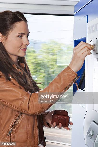 woman at ticket machine in a train - inserting stock pictures, royalty-free photos & images