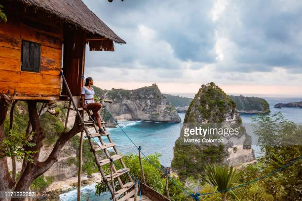 woman at treehouse, nusa penida, bali, indonesia - tree house stock pictures, royalty-free photos & images