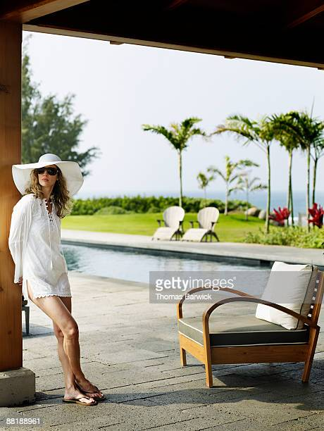 Woman at tropical resort pool in background