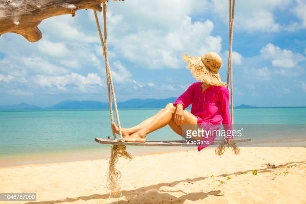 Woman at tropical swing