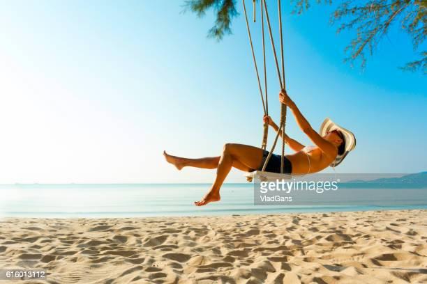 woman at tropical swing - columpiarse fotografías e imágenes de stock