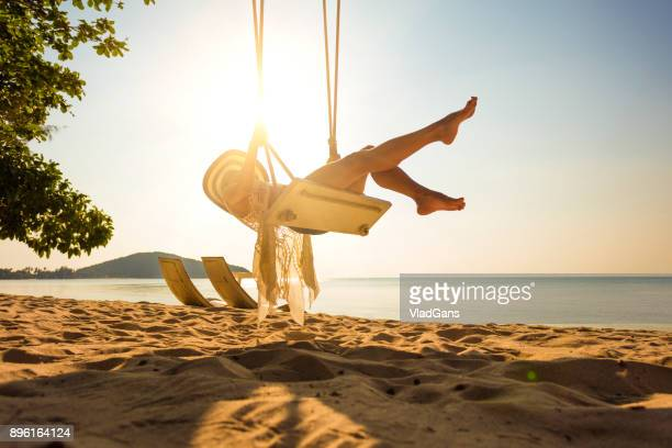 Woman at tropical swing