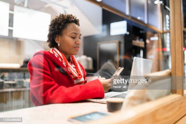 woman at work checking phone. - fiji stock pictures, royalty-free photos & images
