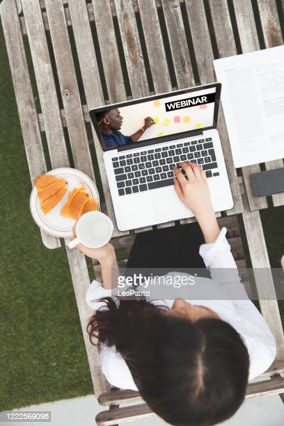 woman at work from home in quarantine lockdown due to coronavirus - makeshift stock pictures, royalty-free photos & images