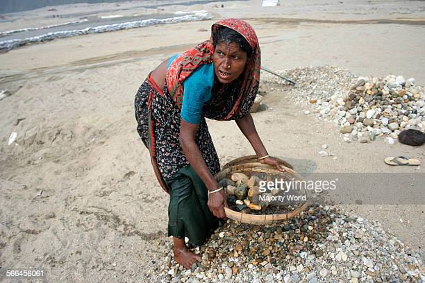 A woman at work on the banks of Dauki river The river in its downward journey from the Himalayas carries an abundance of rocks and boulders and these...