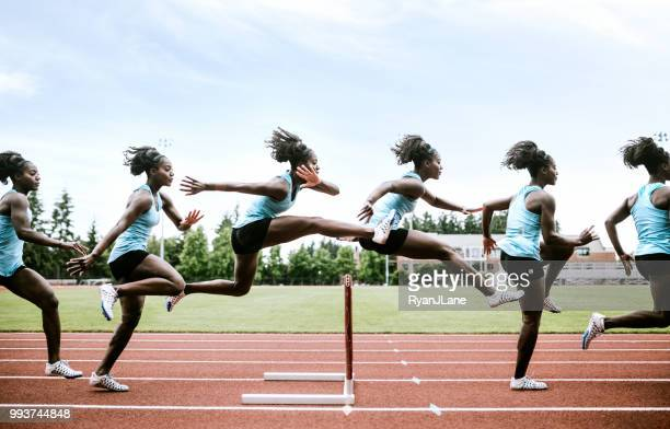 woman athlete runs hurdles for track and field - hurdling track event stock pictures, royalty-free photos & images