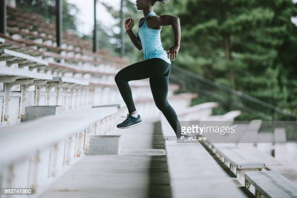 Woman Athlete Runs Stairs for Track and Field