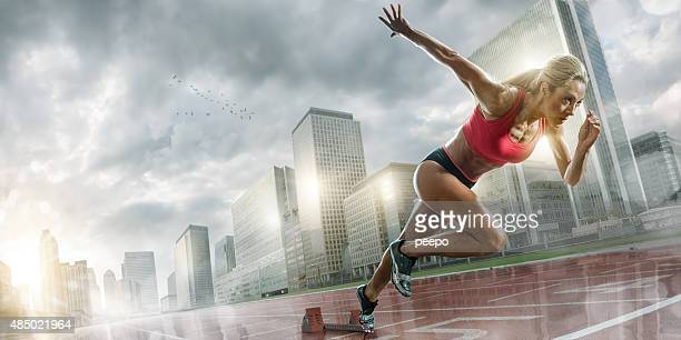 Woman Athlete Sprinting in Wet City