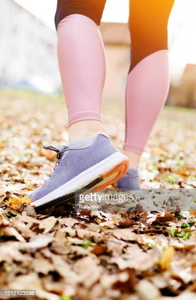 woman athlete stretching out in nature - ivanjekic stock pictures, royalty-free photos & images