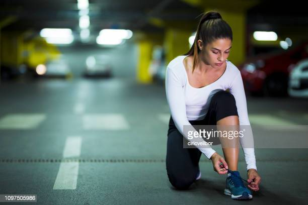 woman athlete tying snekears before training - shoelace stock pictures, royalty-free photos & images
